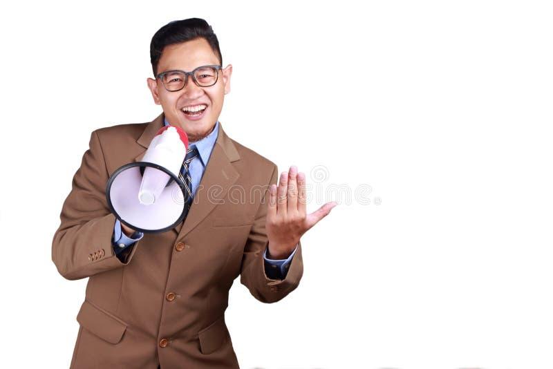 Hombre de negocios joven Using Megaphone, promoviendo gesto fotografía de archivo libre de regalías