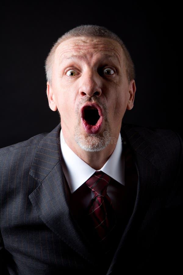 Hombre de negocios que grita en la cámara imágenes de archivo libres de regalías