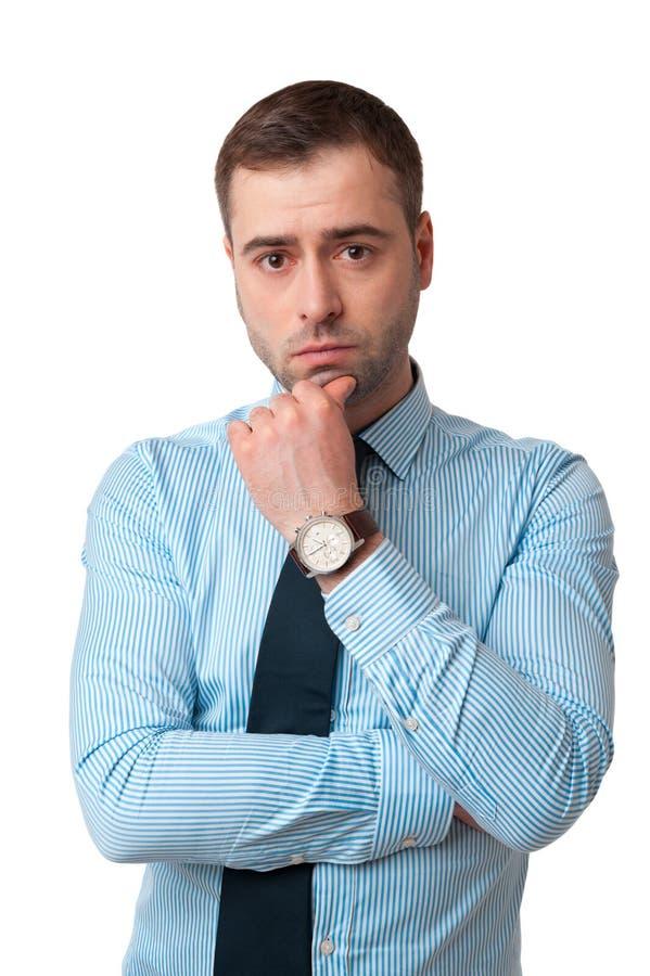 Hombre de negocios maduros de pensamiento en camisa con el finger en isolat de la barbilla imágenes de archivo libres de regalías