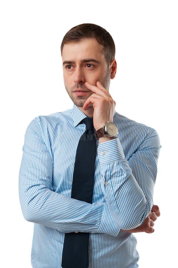 Hombre de negocios maduros pensativo con la mano en la cara aislada en whi fotografía de archivo
