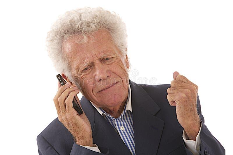 Hombre de negocios mayor en el teléfono fotografía de archivo