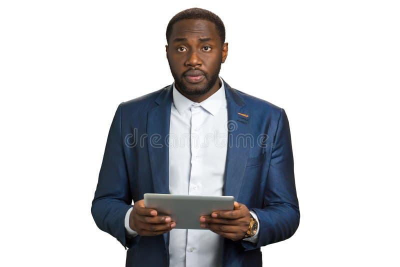 Hombre de negocios negro que parece trastornado imagen de archivo libre de regalías