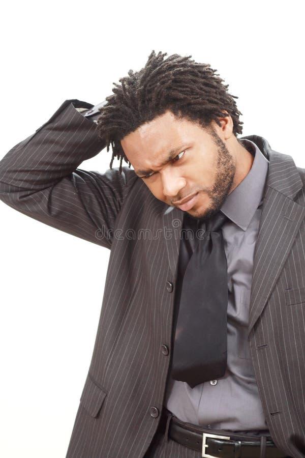 Hombre de negocios negro trastornado foto de archivo
