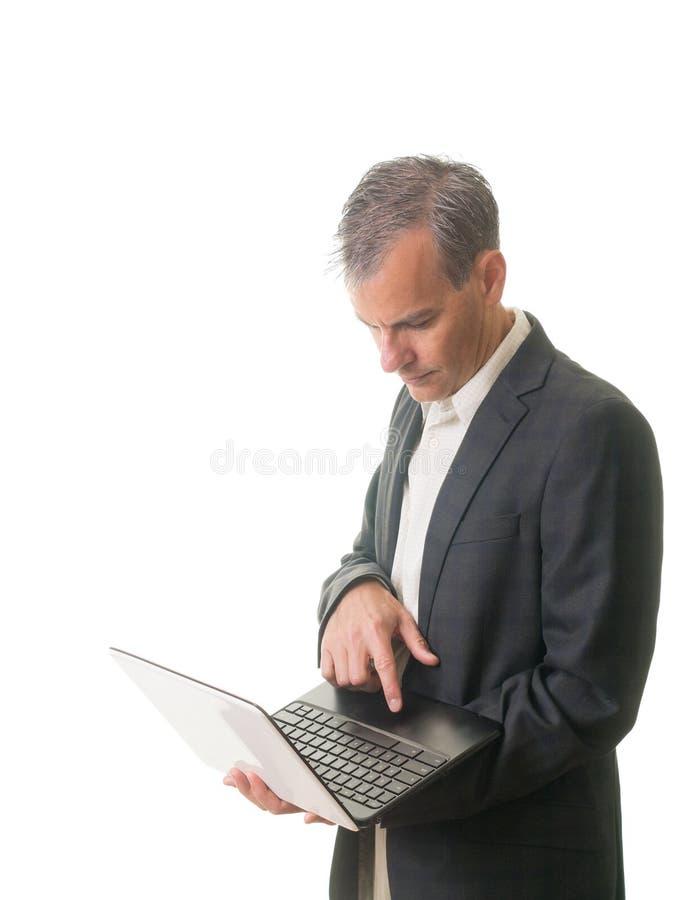 Hombre de negocios ocasional usando la computadora portátil imagen de archivo