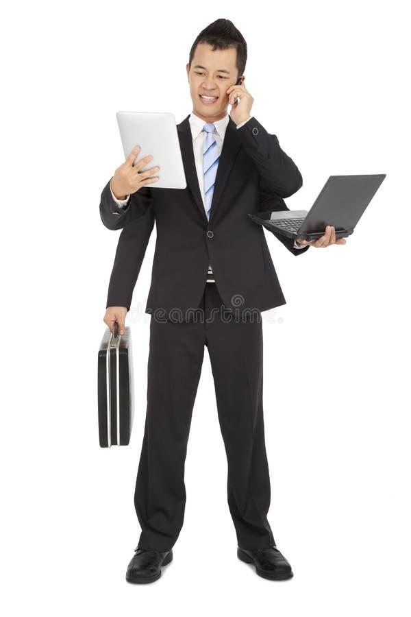 Hombre de negocios ocupado imagen de archivo