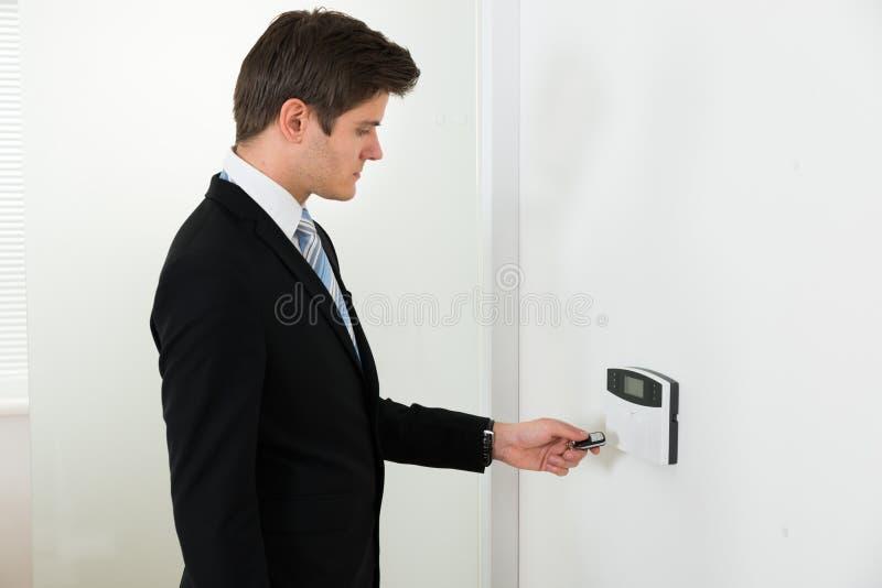 Hombre de negocios Operating Security System fotos de archivo