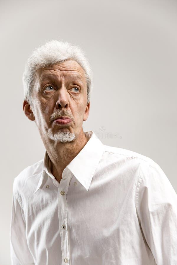 Hombre de negocios pensativo serio Concepto de la duda imagenes de archivo