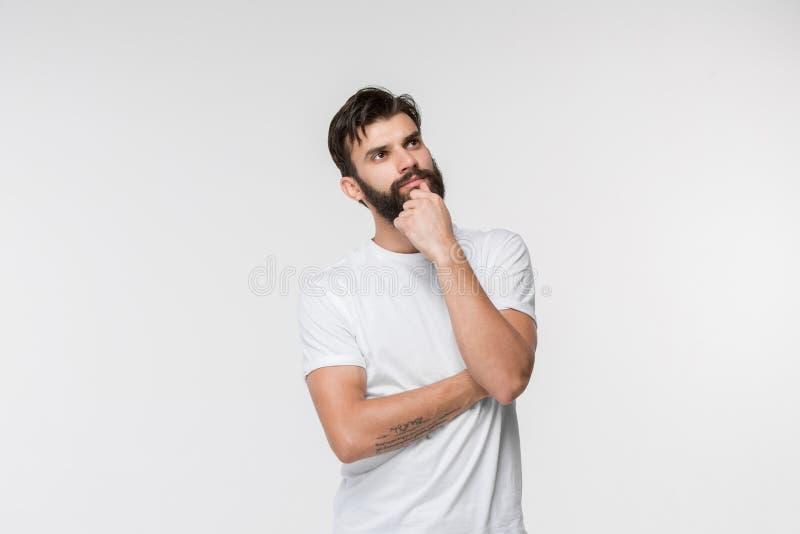 Hombre de negocios pensativo serio joven Concepto de la duda foto de archivo libre de regalías