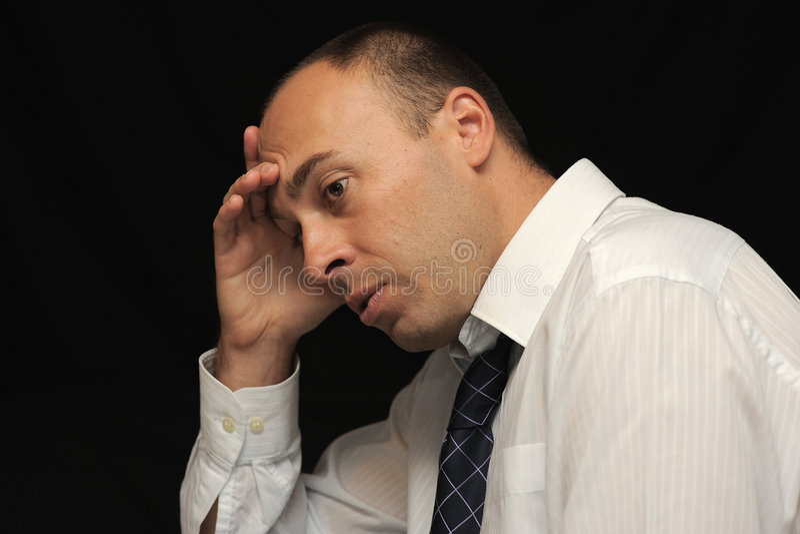 Hombre de negocios preocupante foto de archivo