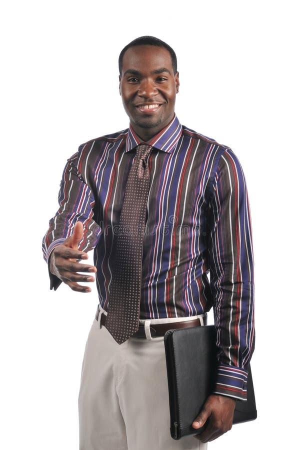 Hombre de negocios que amplía una sacudida de la mano fotografía de archivo libre de regalías