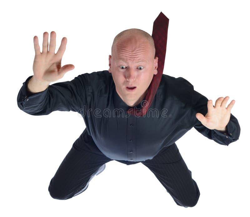Hombre de negocios que cae fotografía de archivo libre de regalías