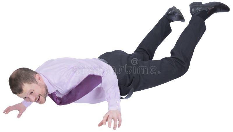 Hombre de negocios que cae abajo en el fondo blanco fotos de archivo libres de regalías