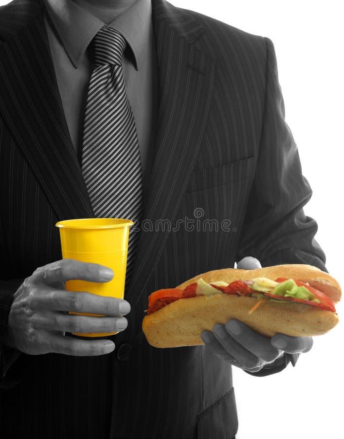 Hombre De Negocios Que Come Los Alimentos De Preparación Rápida De Los Desperdicios Imagen de archivo libre de regalías