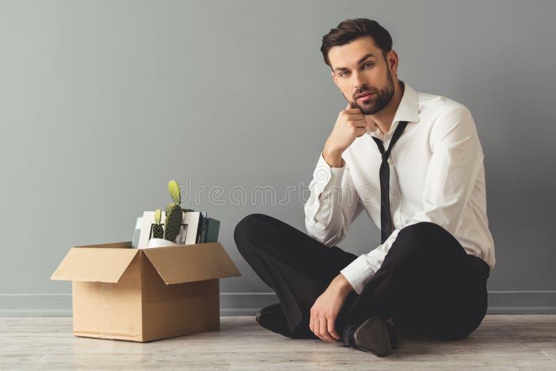 Hombre de negocios que consigue encendido foto de archivo libre de regalías
