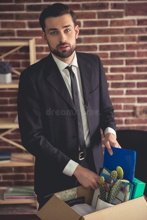 Hombre de negocios que consigue encendido fotografía de archivo libre de regalías