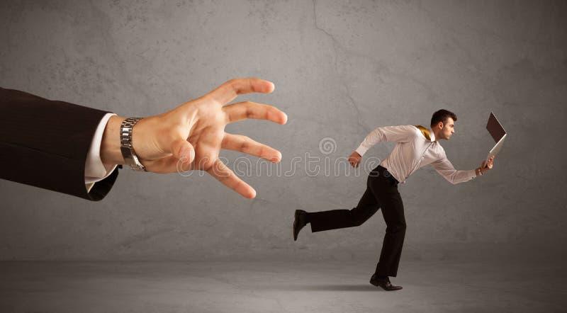 Hombre de negocios que corre de la mano fotografía de archivo libre de regalías