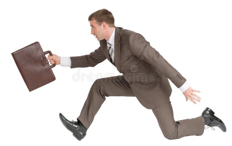 Hombre de negocios que corre rápidamente con la maleta en blanco imagenes de archivo