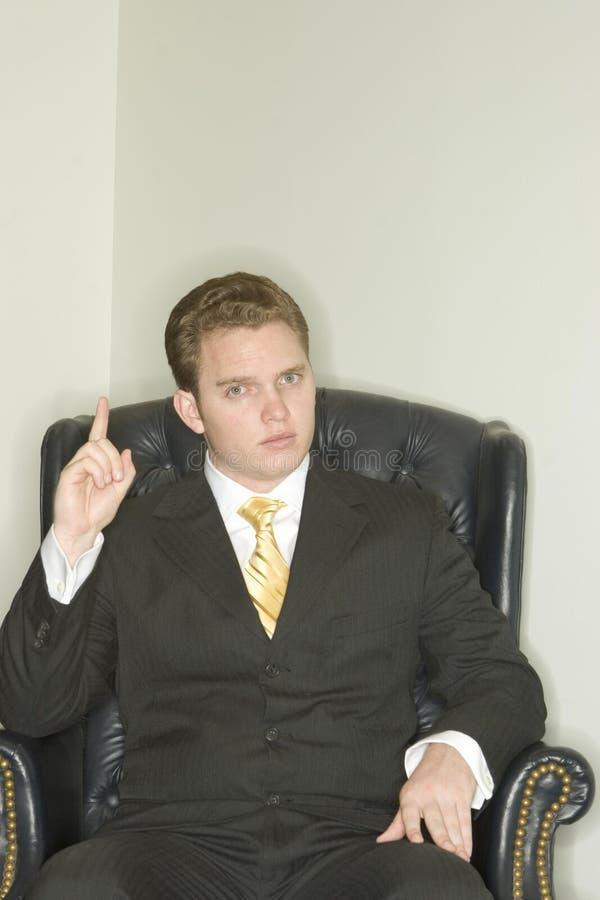 Hombre de negocios que destaca foto de archivo