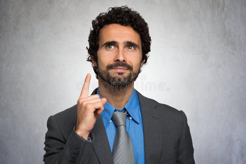Hombre de negocios que destaca su finger imagen de archivo