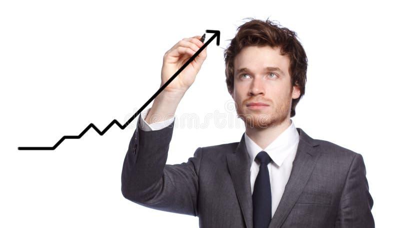 Hombre de negocios que drena un gráfico foto de archivo libre de regalías