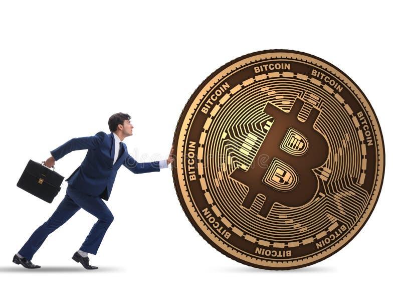 Hombre de negocios que empuja el bitcoin en concepto del blockchain del cryptocurrency fotos de archivo libres de regalías