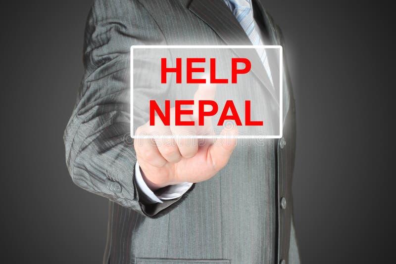 Hombre de negocios que empuja el botón virtual de Nepal de la ayuda foto de archivo