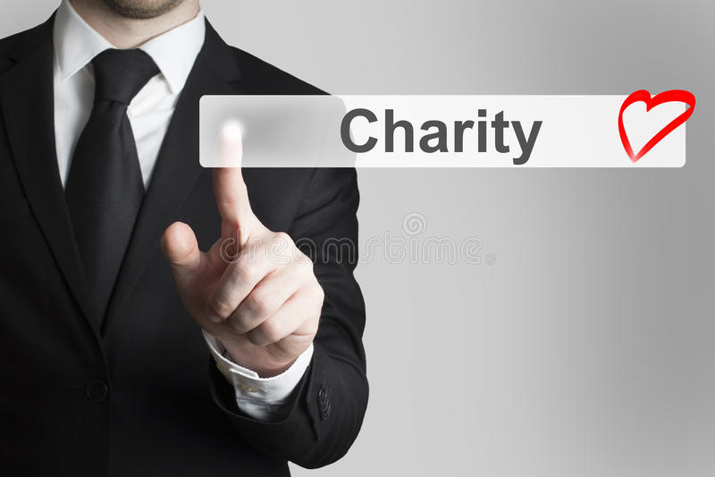 Hombre de negocios que empuja el corazón plano de la caridad del botón fotografía de archivo libre de regalías