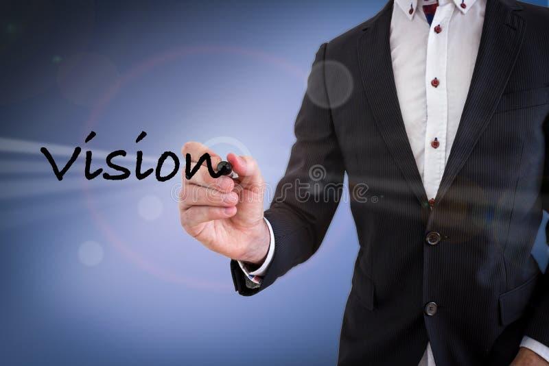 Hombre de negocios que escribe Vision imagen de archivo libre de regalías