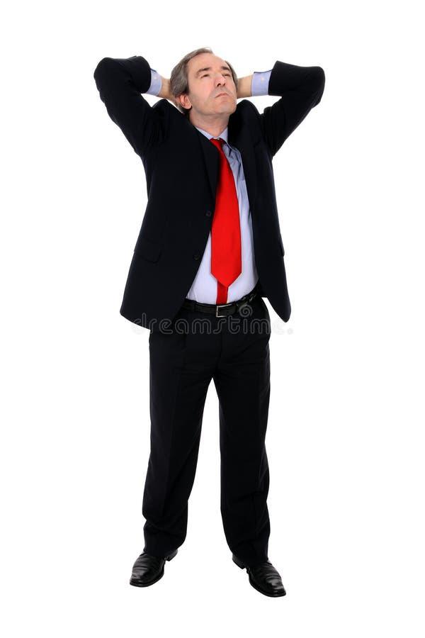 Hombre de negocios que estira sus brazos fotografía de archivo libre de regalías