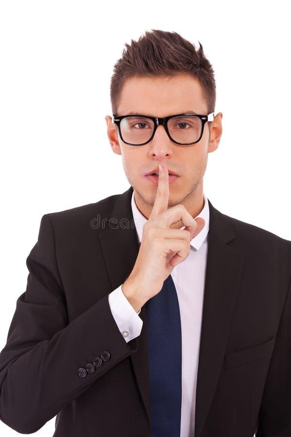 Hombre de negocios que guarda silencio imagen de archivo libre de regalías