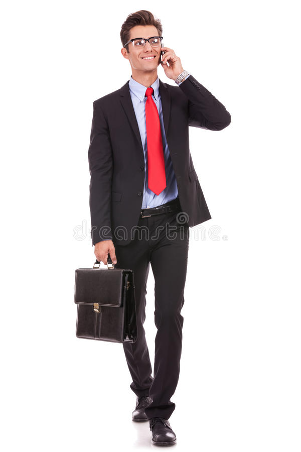 Hombre de negocios que habla y que recorre imagenes de archivo