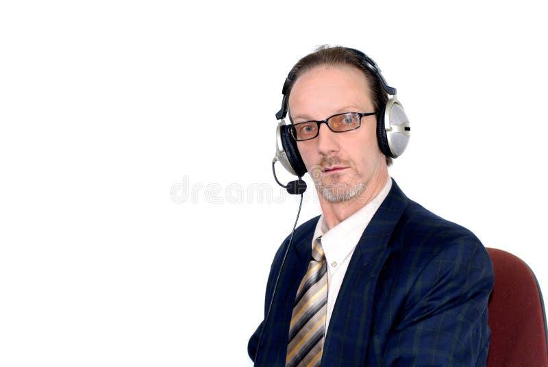 Hombre de negocios que hace audioconferencia del Internet fotos de archivo libres de regalías