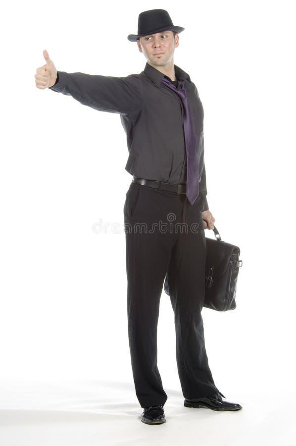 Hombre de negocios que hace autostop imagen de archivo