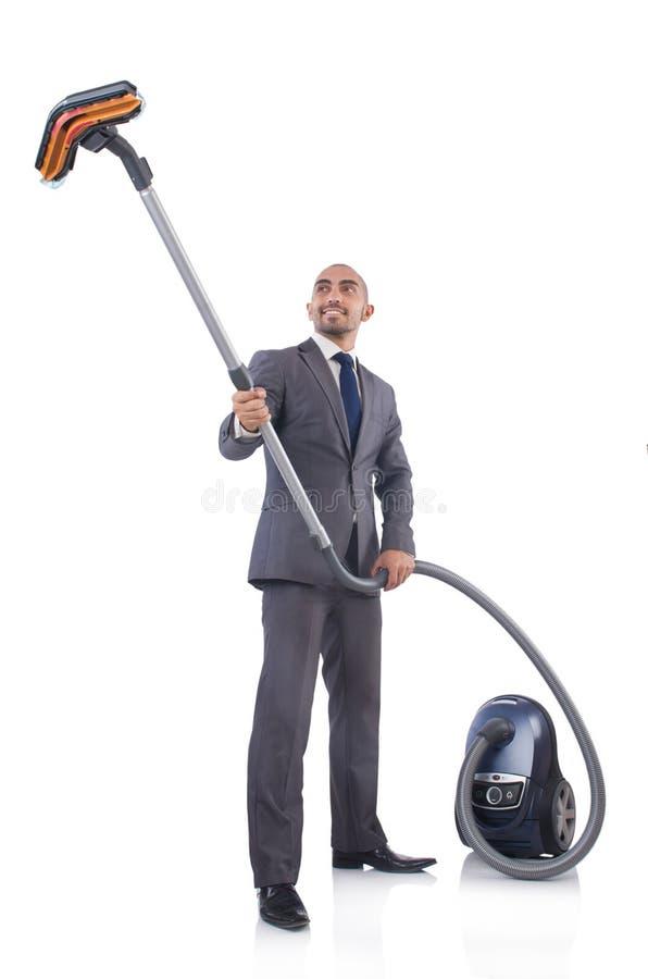 Hombre De Negocios Que Hace La Limpieza Del Vacío Foto de archivo