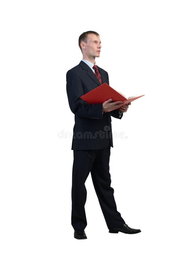 Hombre de negocios que lee el libro rojo fotografía de archivo libre de regalías