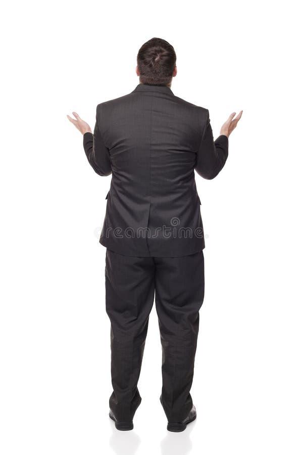 Hombre de negocios que levanta los brazos en incredulidad fotografía de archivo libre de regalías