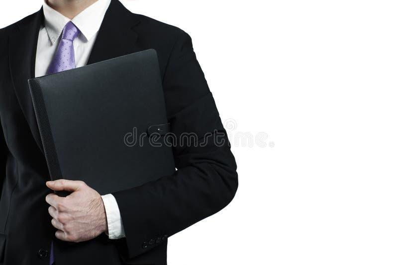 Hombre de negocios que lleva a cabo la lista de cuero negra foto de archivo libre de regalías