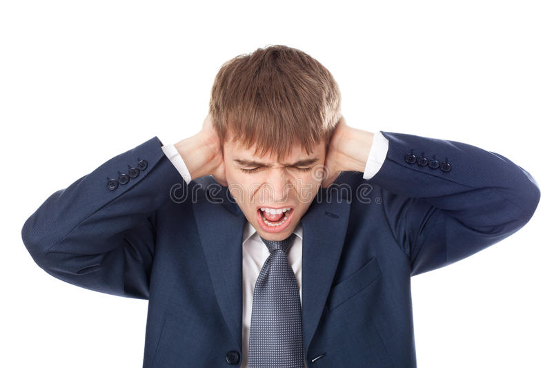 Hombre de negocios que lleva a cabo las manos en sus oídos imagenes de archivo
