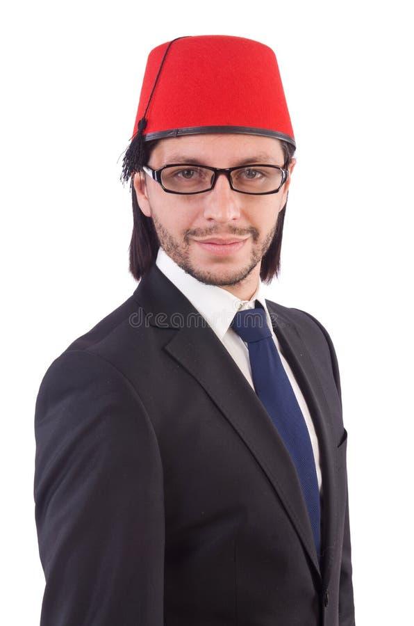 Hombre de negocios que lleva el sombrero de Fes aislado foto de archivo libre de regalías