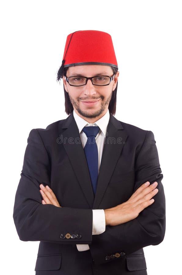 Hombre de negocios que lleva el sombrero de Fes aislado imagen de archivo