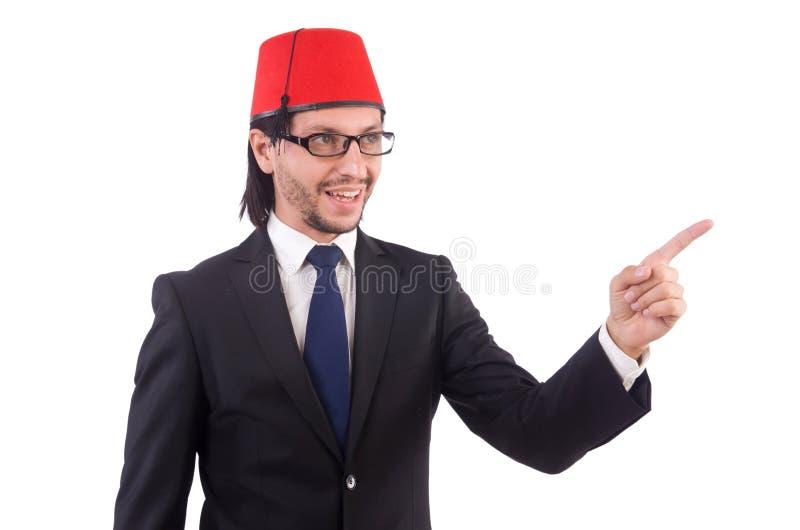 Hombre de negocios que lleva el sombrero de Fes aislado imagen de archivo libre de regalías