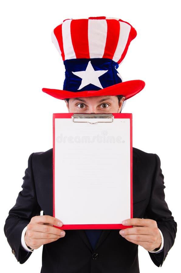 Hombre de negocios que lleva el sombrero de los E.E.U.U. con el papel fotografía de archivo libre de regalías