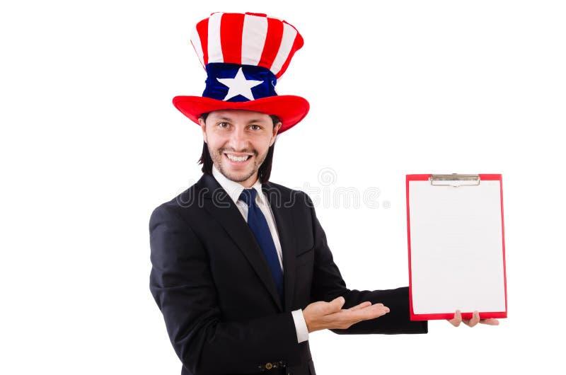 Hombre de negocios que lleva el sombrero de los E.E.U.U. con el papel fotos de archivo libres de regalías