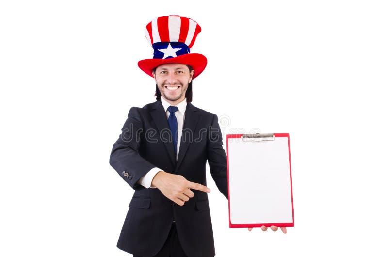 Hombre de negocios que lleva el sombrero de los E.E.U.U. con el papel fotos de archivo