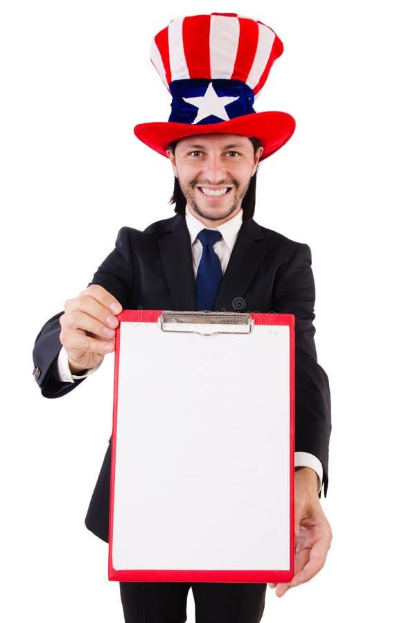 Hombre de negocios que lleva el sombrero de los E.E.U.U. con el papel foto de archivo