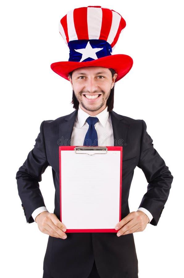 Hombre de negocios que lleva el sombrero de los E.E.U.U. con el papel imagenes de archivo