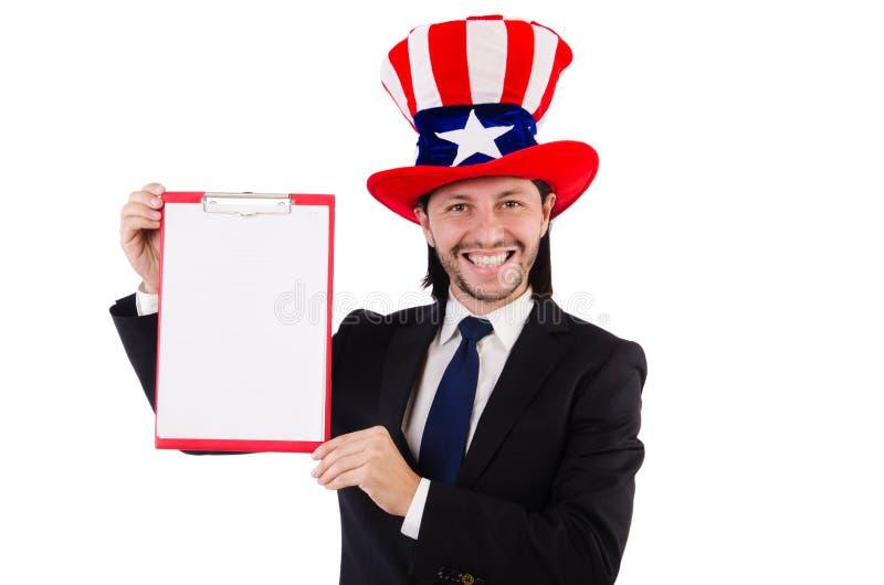 Hombre de negocios que lleva el sombrero de los E.E.U.U. con el papel imagen de archivo