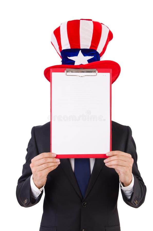 Hombre de negocios que lleva el sombrero de los E.E.U.U. con el papel fotografía de archivo