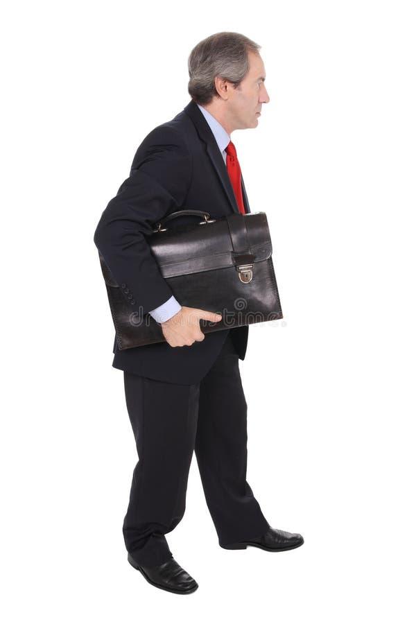 Hombre de negocios que lleva una cartera imagenes de archivo