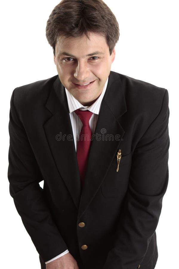 Hombre de negocios que mira para arriba sonriente imagenes de archivo